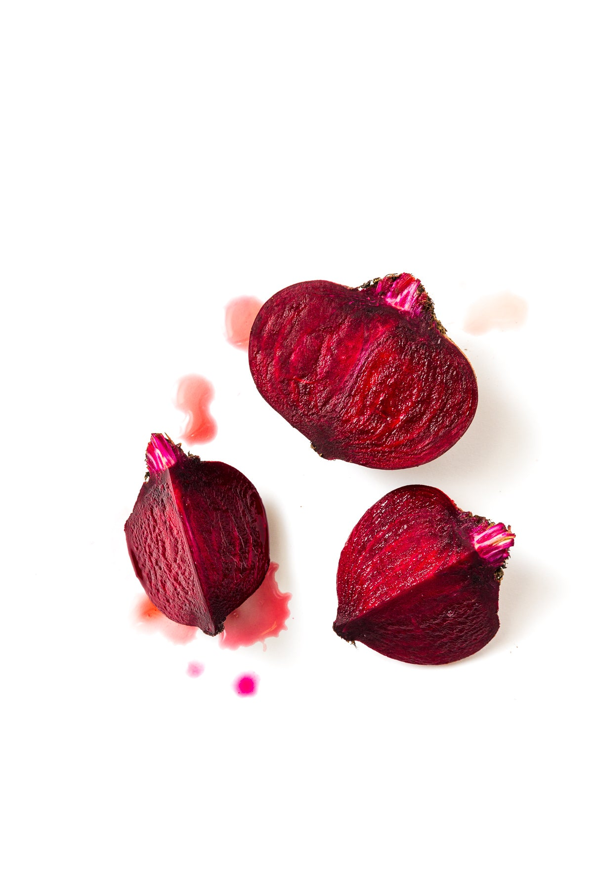 Image of top of three red beets used for Miss Jones Baking Co Beet Red Velvet Layer Cake