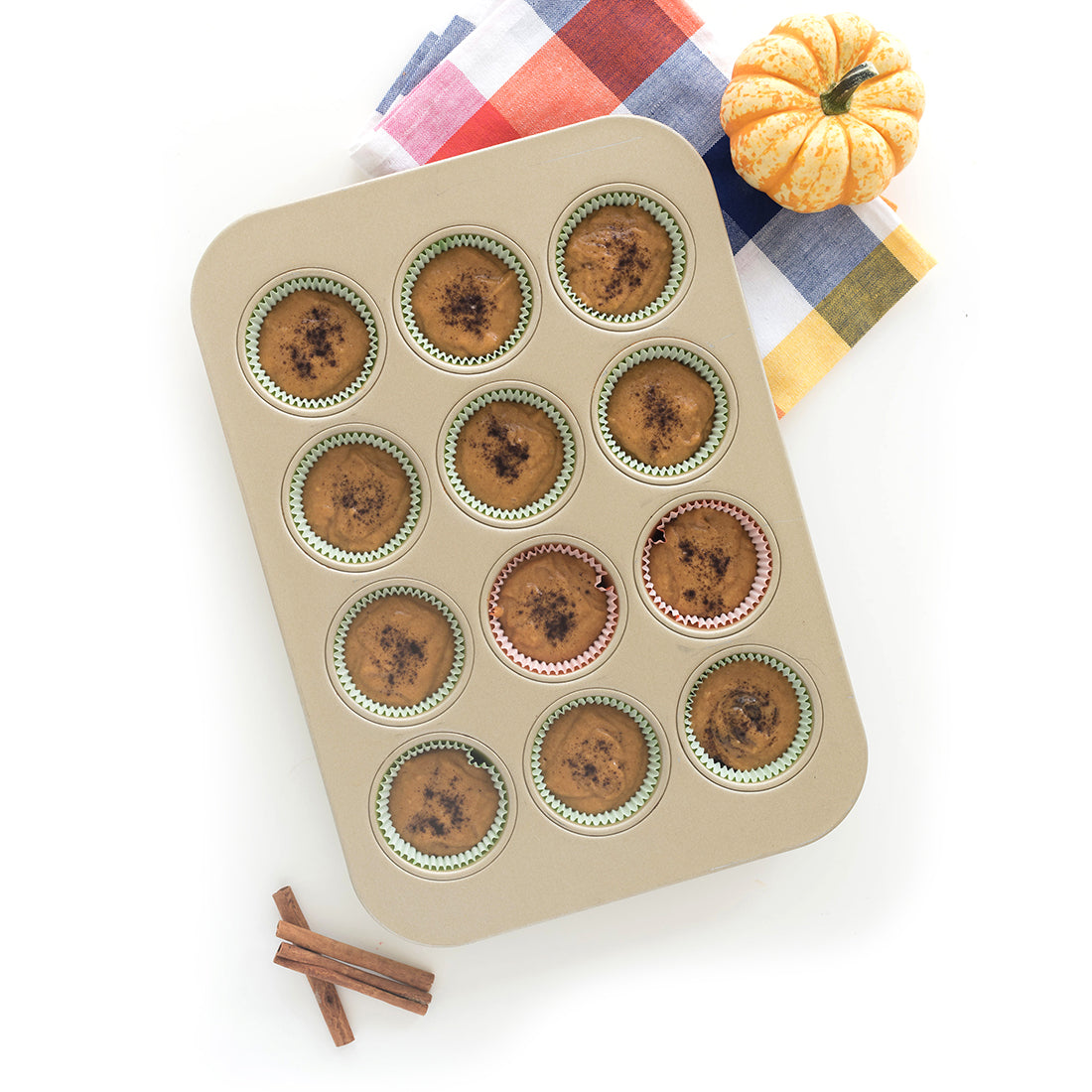 Image from above of Miss Jones Baking Co Pumpkin Spice Latte (PSL) Cupcake batter in a cupcake baking tin
