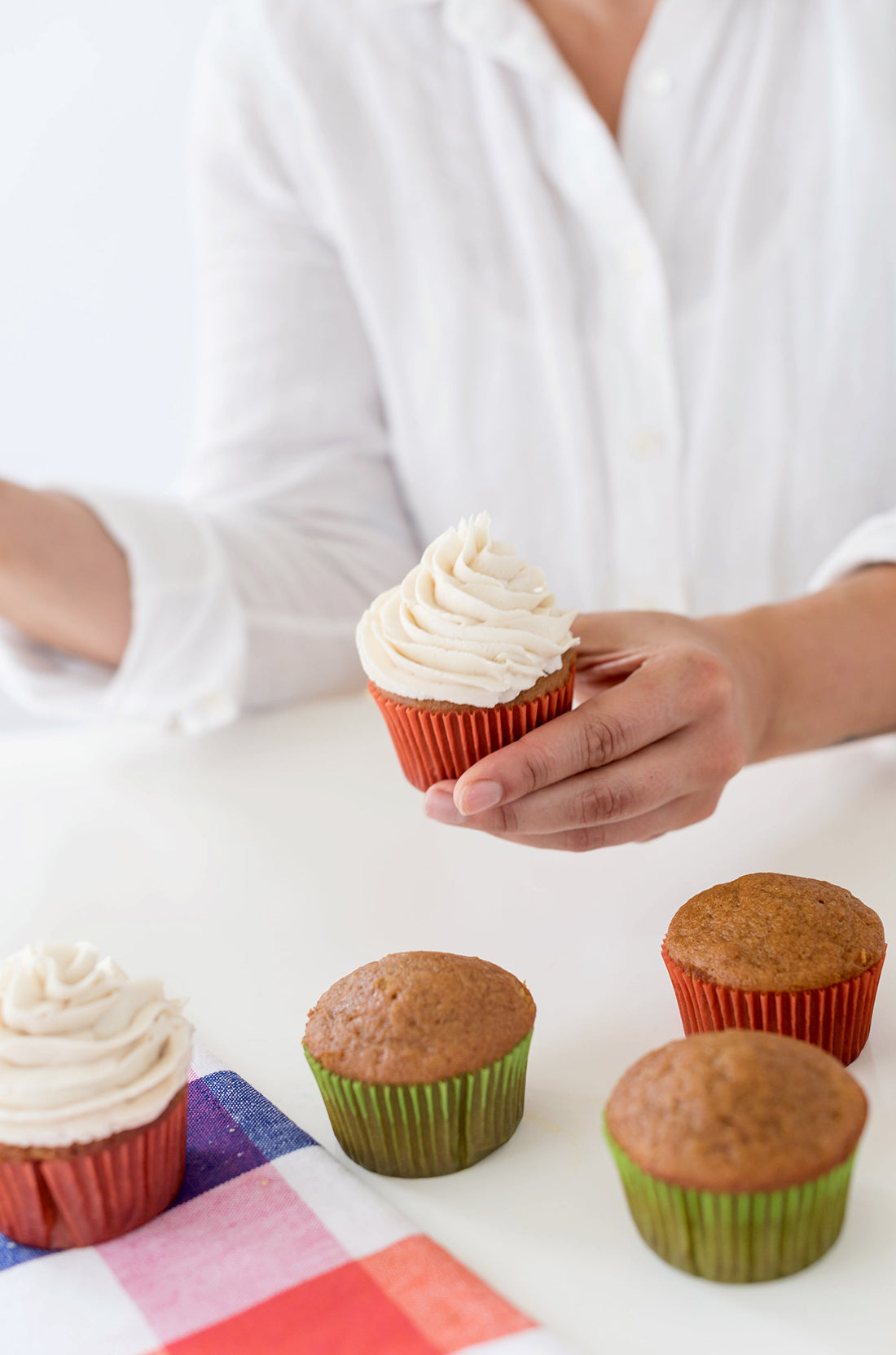 Image of a person frosting Miss Jones Baking Co Pumpkin Spice Latte (PSL) Cupcakes