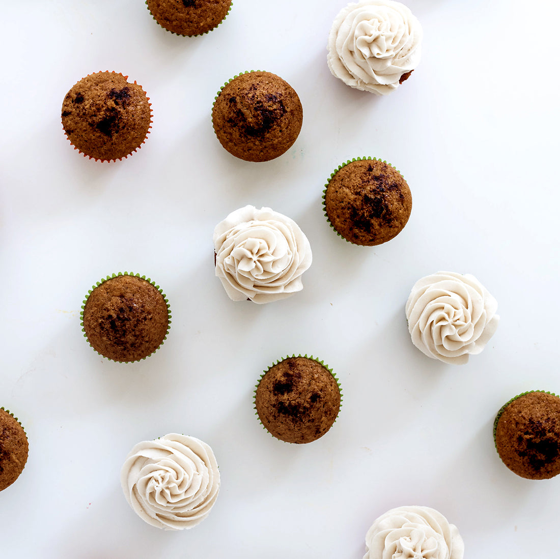 Image from above of some frosted and some unfrosted Miss Jones Baking Co Pumpkin Spice Latte (PSL) Cupcakes