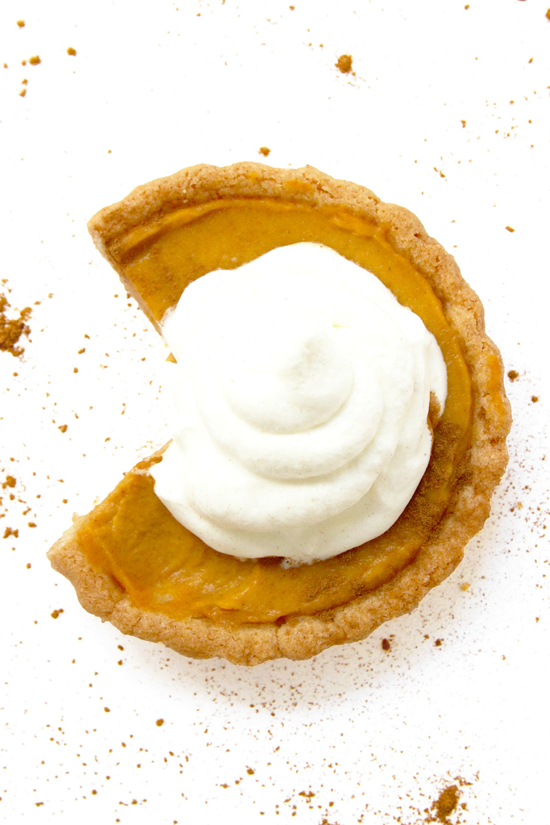 Image of the top of a Miss Jones Baking Co Perfect Pumpkin Tartlet with a slice taken out of it