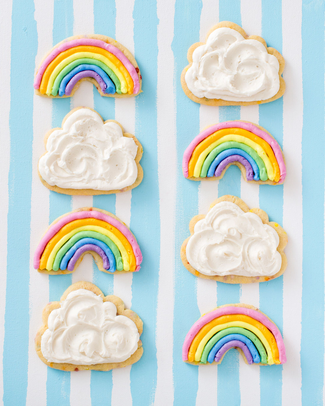 Image of eight Miss Jones Baking Co Chewy and Soft Rainbow and Cloud Frosted Confetti Sugar Cookies