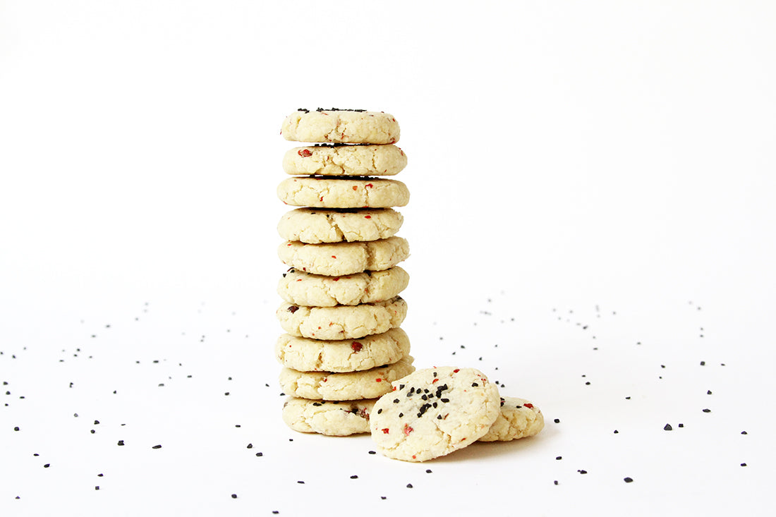 Image of the side of a stack of Miss Jones Baking Co Salt + Pepper Shortbread cookies