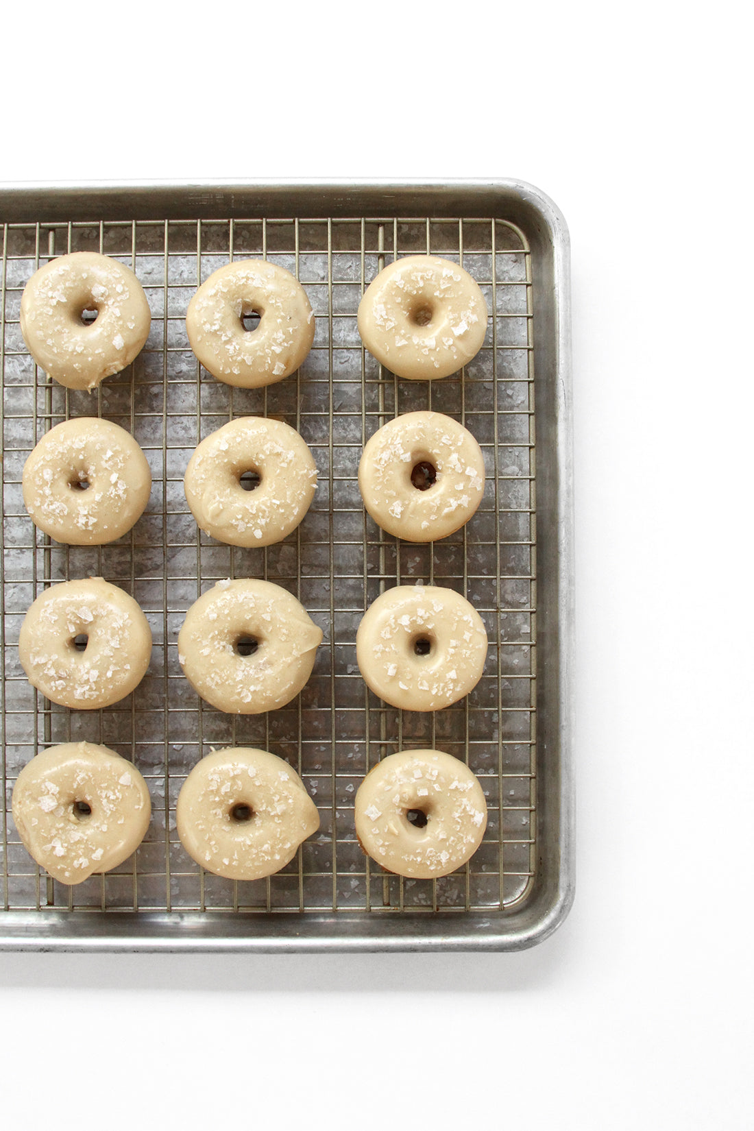 Image of 12 Miss Jones Baking Co Salted Maple Donuts on a baking rack