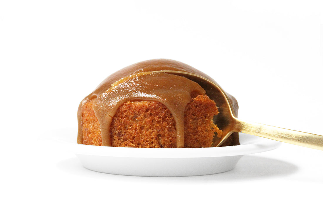 Image from the side of a spoon taking a bite of a Miss Jones Baking Co Sticky Toffee Cake