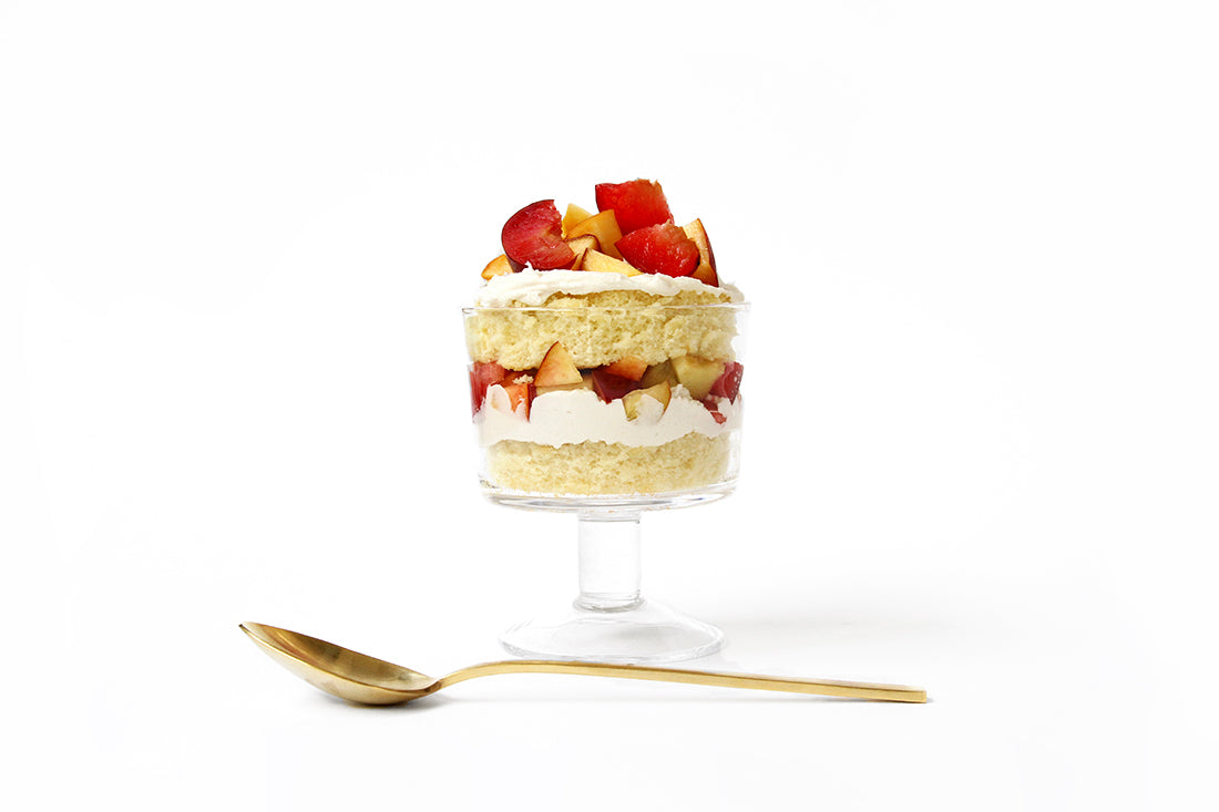 Image of Miss Jones Baking Co Stone Fruit Shortcake from the side next to a golden spoon
