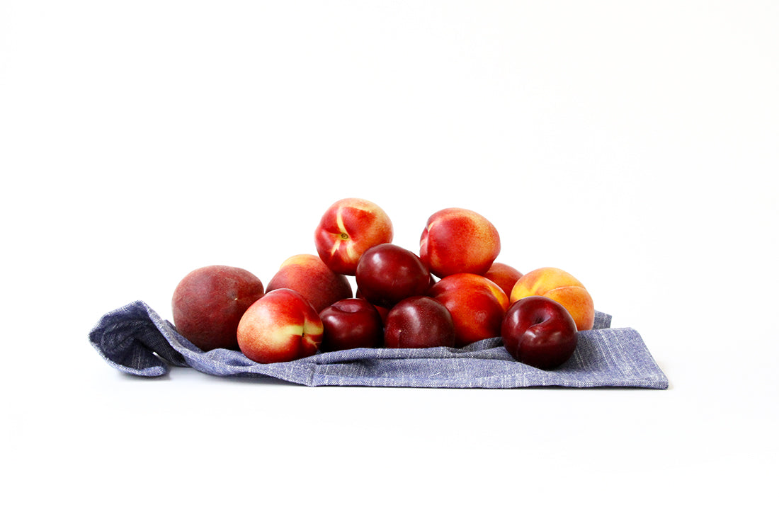 Image from the side of a towel covered in stone fruit for Miss Jones Baking Co Stone Fruit Shortcake Recipe