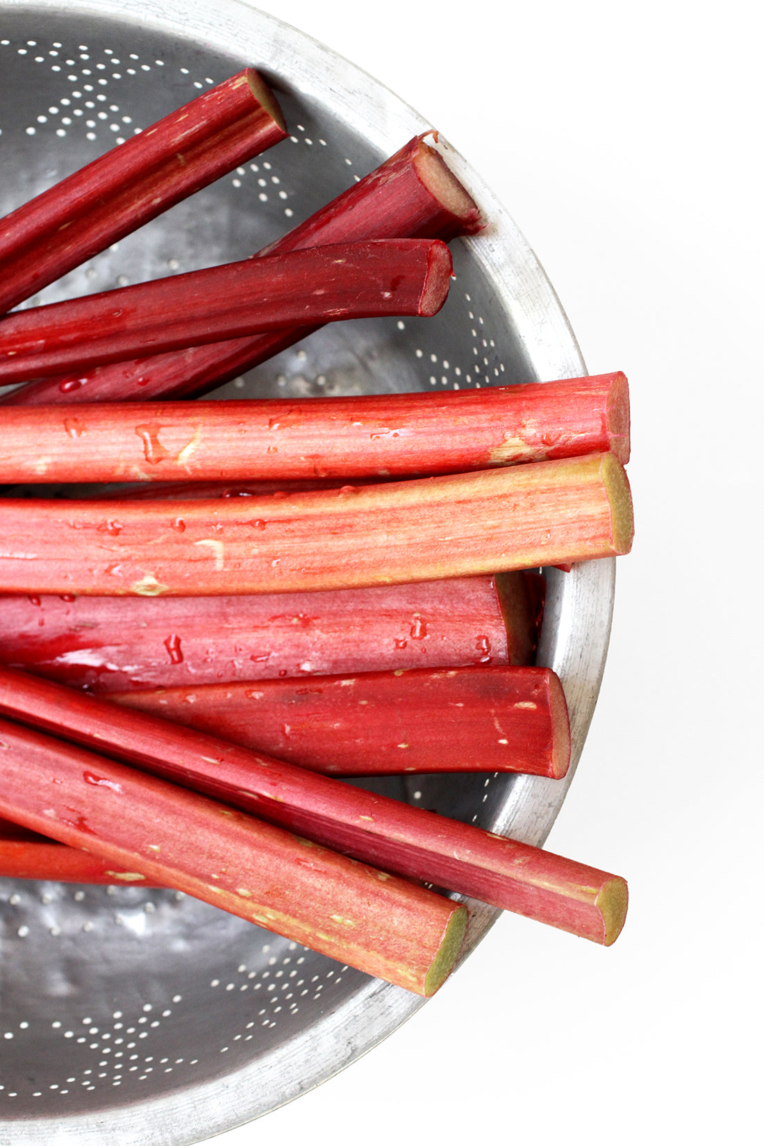 Image from above of part of a strainer full of rhubarb for Miss Jones Baking Co Summer Strawberry + Rhubarb Tart recipe