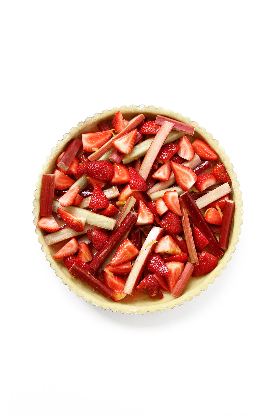 Image from above of an uncooked Miss Jones Baking Co Summer Strawberry + Rhubarb Tart