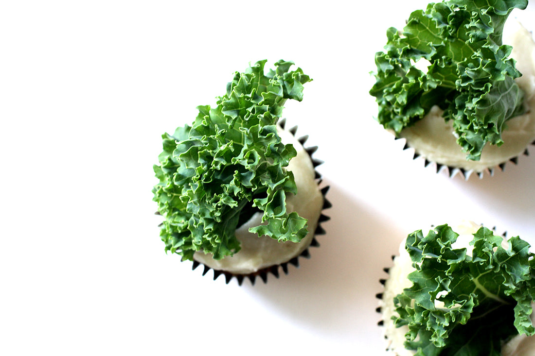 Image from above of three Miss Jones Baking Co Sweet Kale Cupcakes
