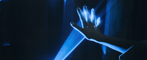 hand blocking blue light