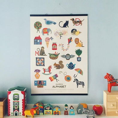 Illustrated Alice Melvin alphabet print in nursery