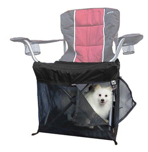 black wrapsit slipcover under seat pet crate on folding quad chair with white American eskimo dog inside looking out