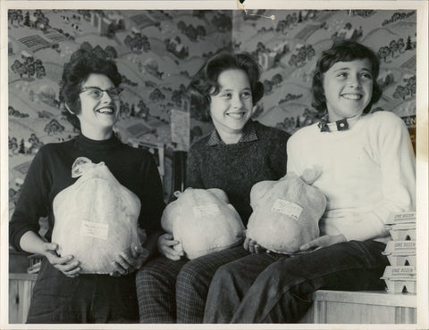 Historic image showing generations of Miller Farms women holding turkeys