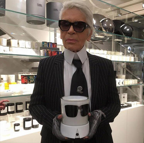 Karl Lagerfeld at Colette holding is Candle Karl