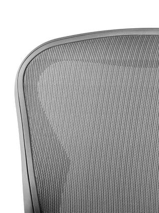 Close-up of the mesh pelicle suspension on the back of a graphite Aeron office chair