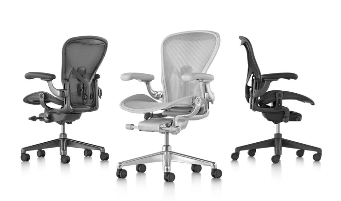 Three Aeron office chairs in mineral, graphite and carbon