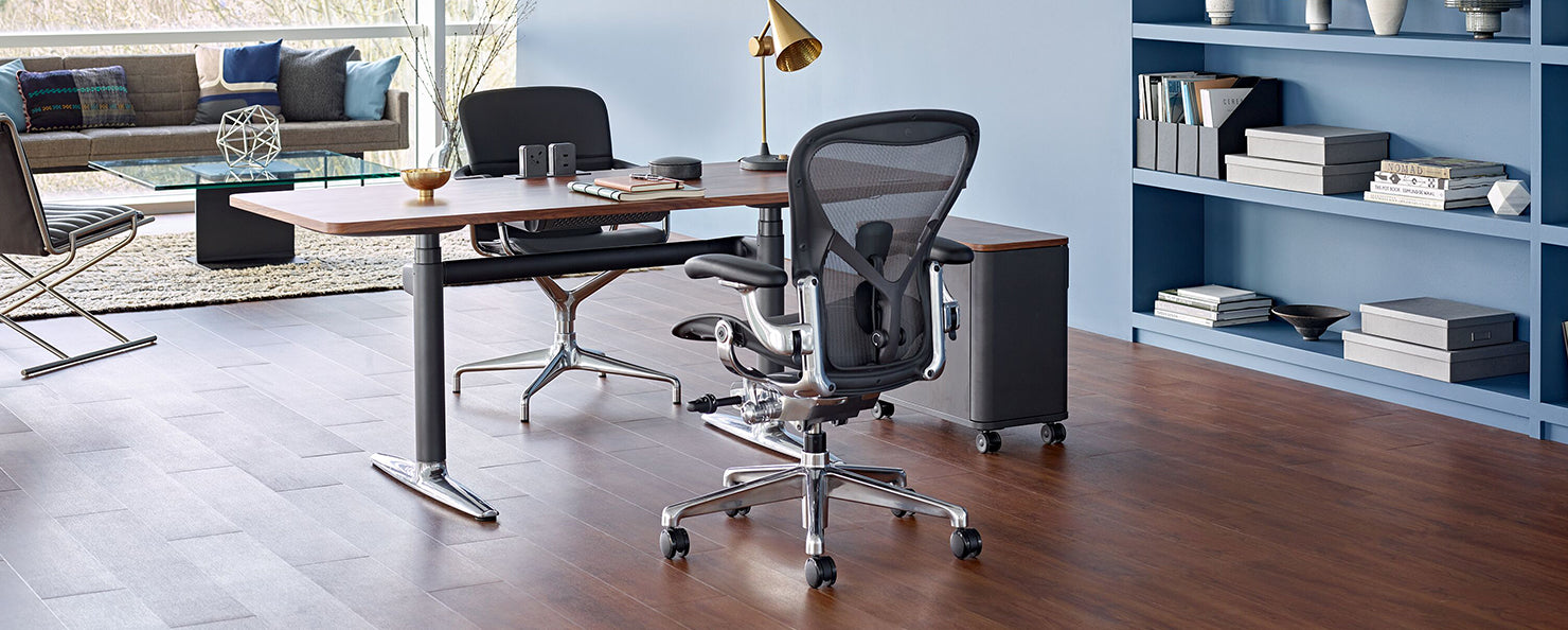 A graphite Aeron with a polished aluminium base in an home office setting