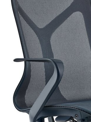 Detail view of a fixed arm on a blue Cosm chair