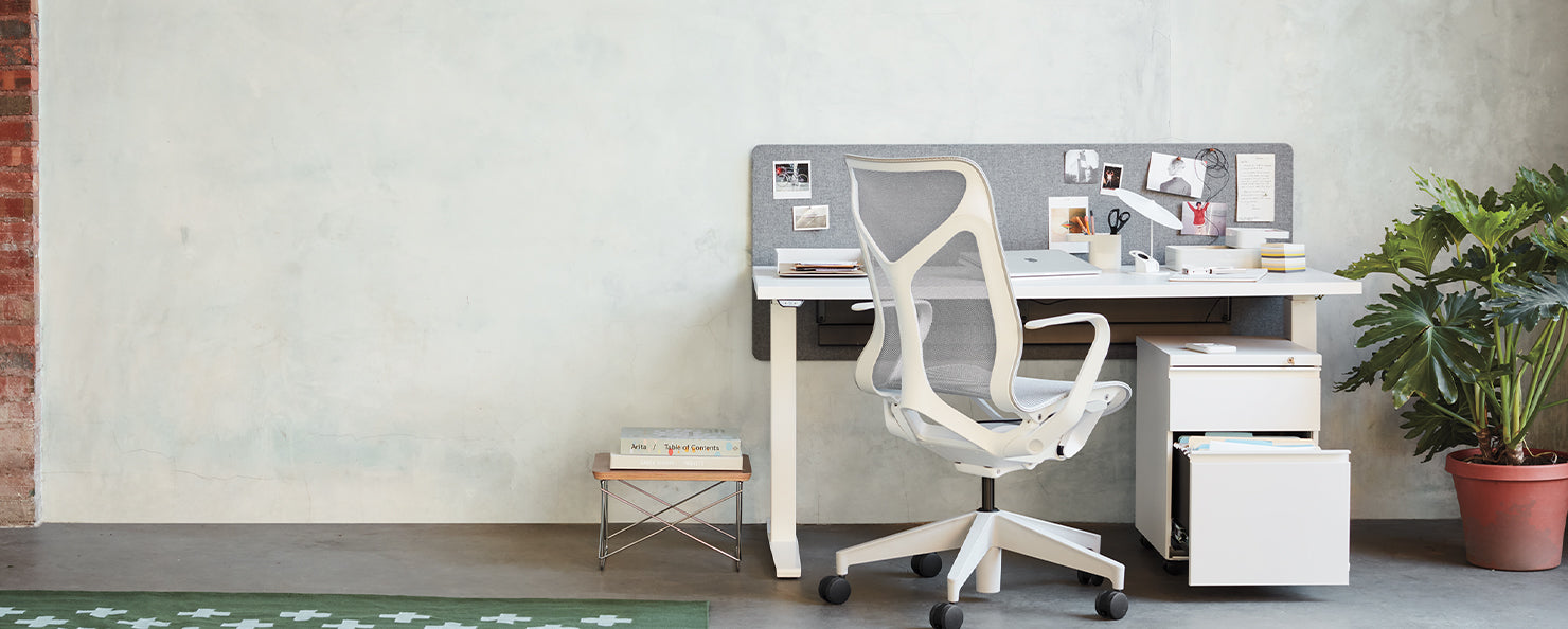 A white and grey Cosm chair in a home office environment