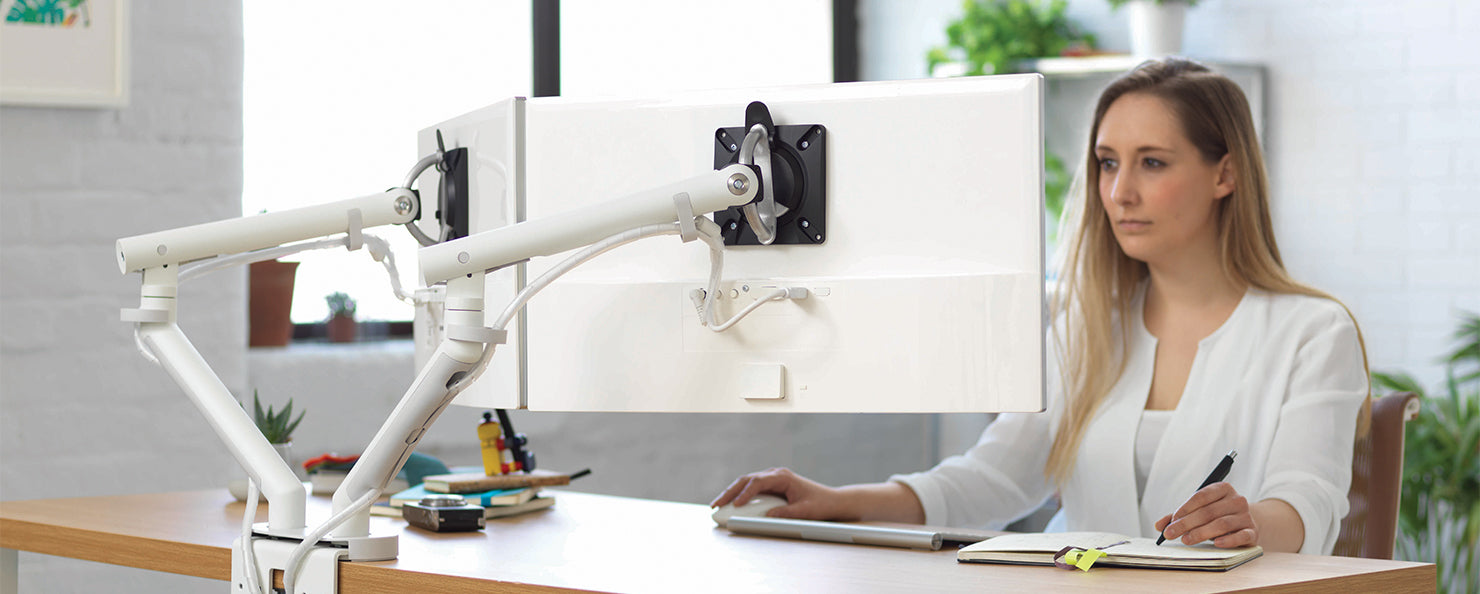 Dual Flo monitor arms in an office setting