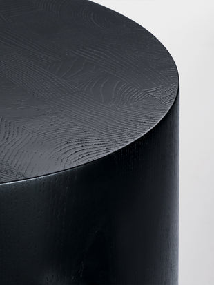Close up of painted black Hew Side Table