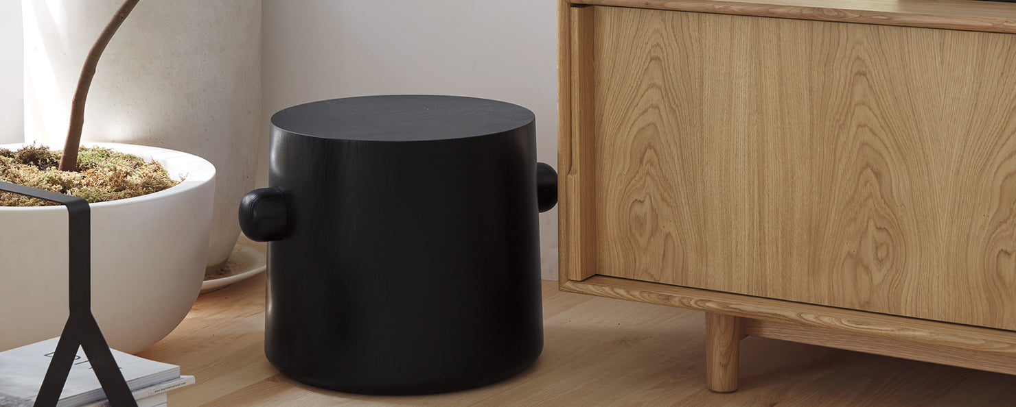 A black Hew side table
