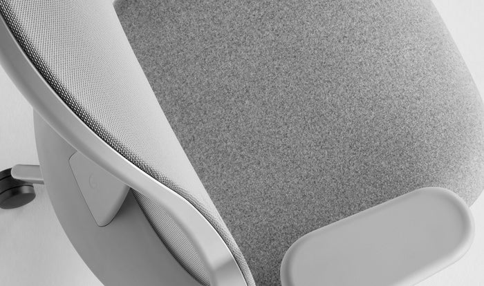 Detailed view of the seat and back of a grey Lino chair