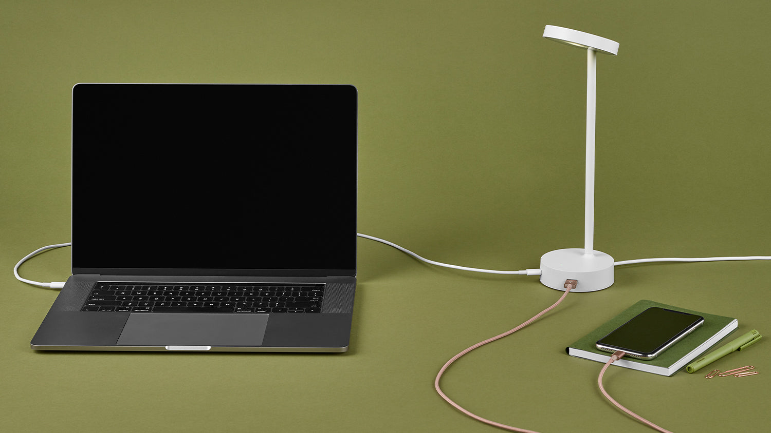 White Lolly personal light charging a laptop and mobile phone
