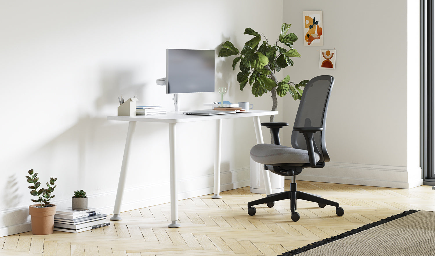 A white Memo desk with grey Lino chair in a home office