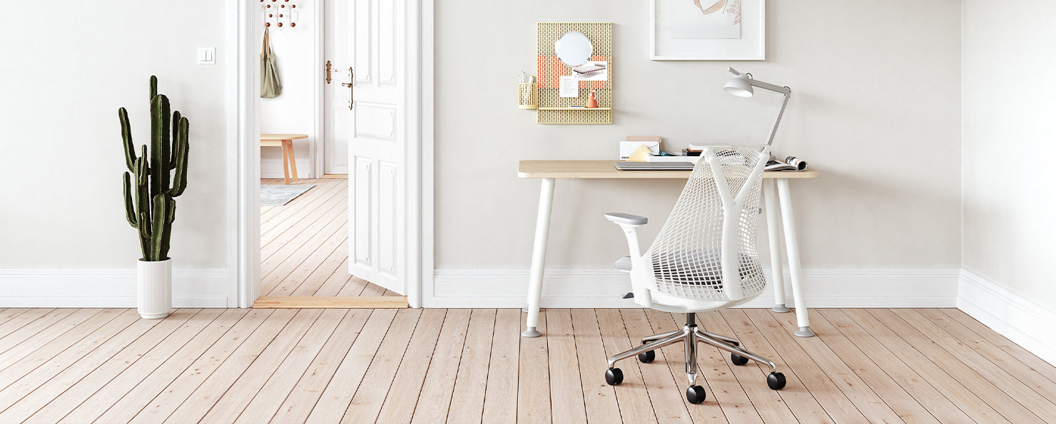 A Memo desk with a white and grey Sayl chair in a home office