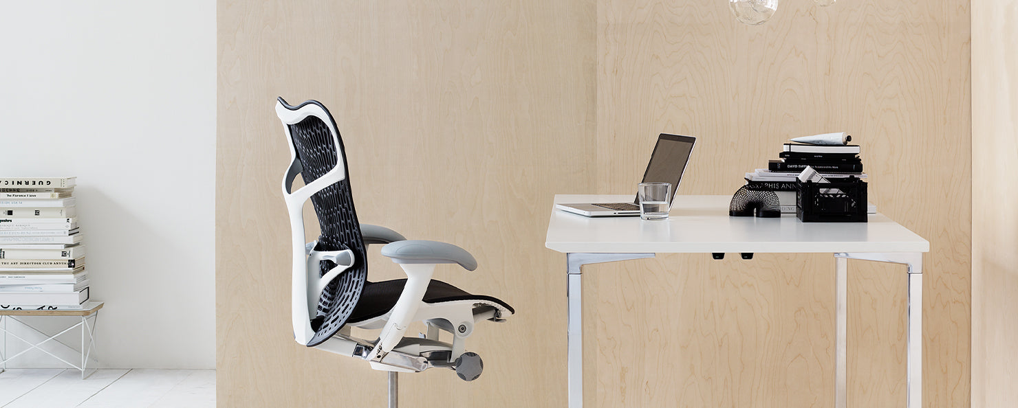 A grey and white Mirra 2 chair in a home office environment.