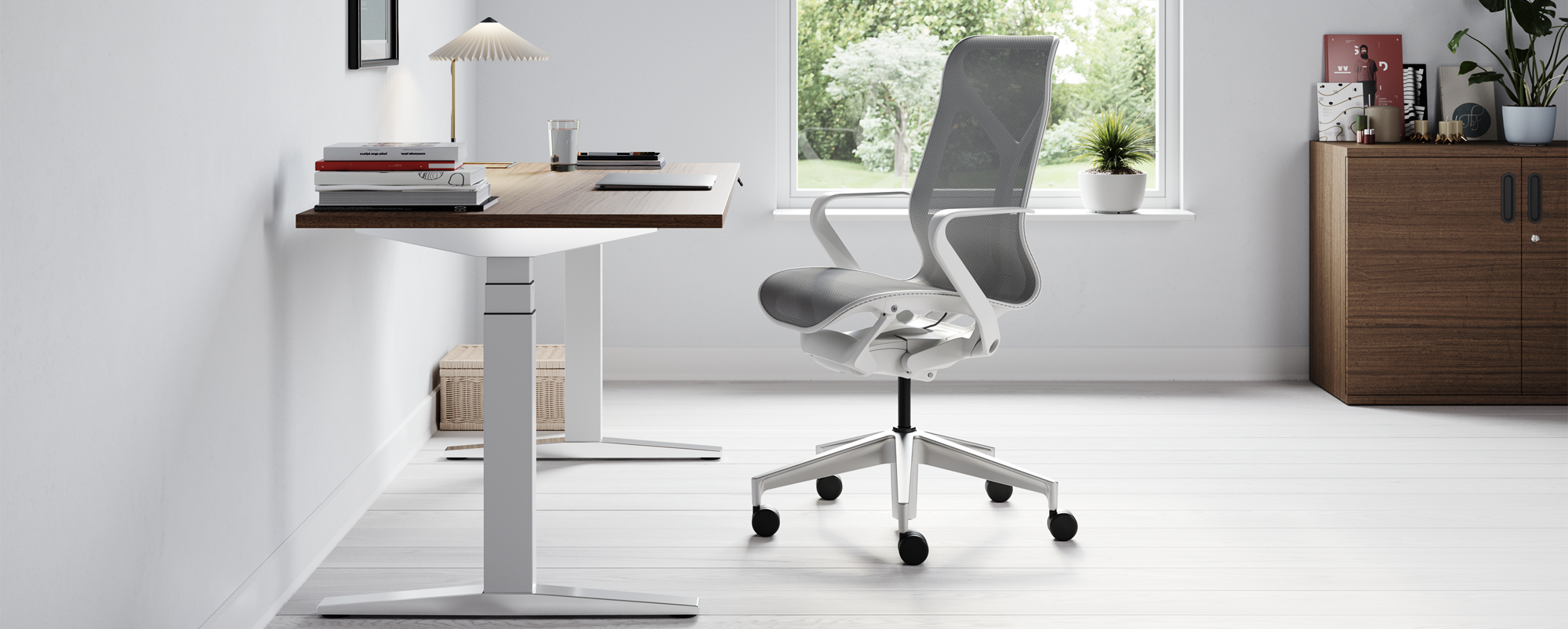 A grey Cosm chair at a Ratio desk