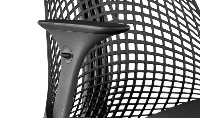 Close up view of the seat and arms on a black Sayl chair
