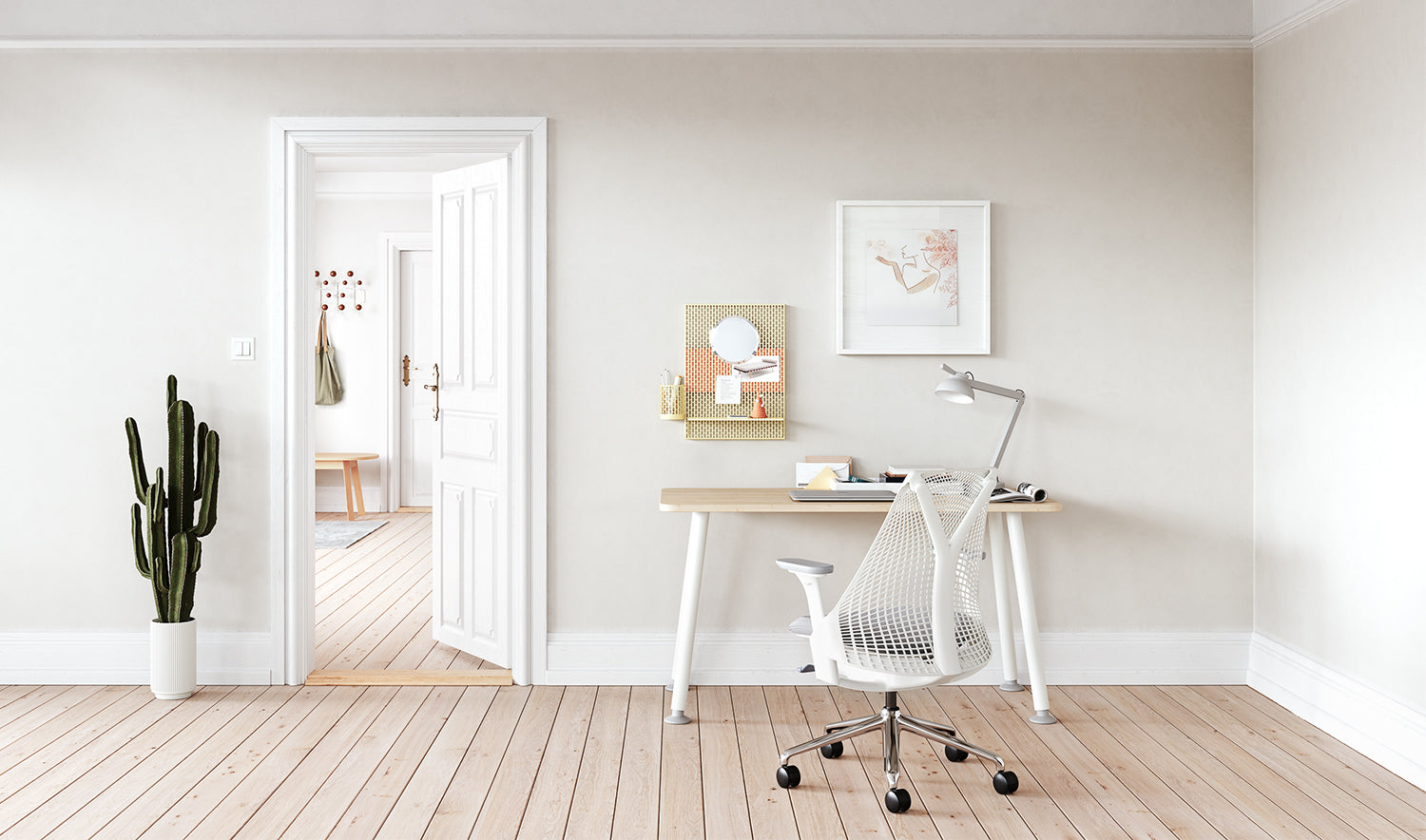 A white and grey Sayl chair alongside a Memo desk in a home office environment