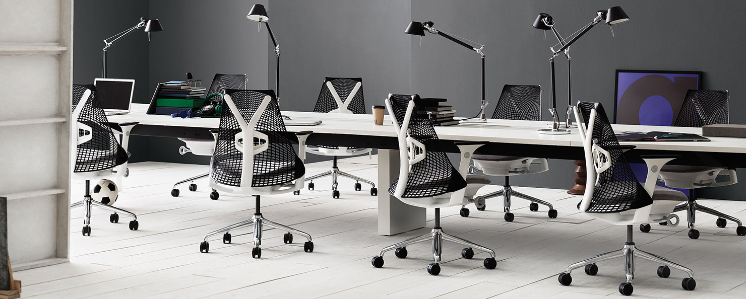White and black Sayl chairs along a desking bench in an office envrionment