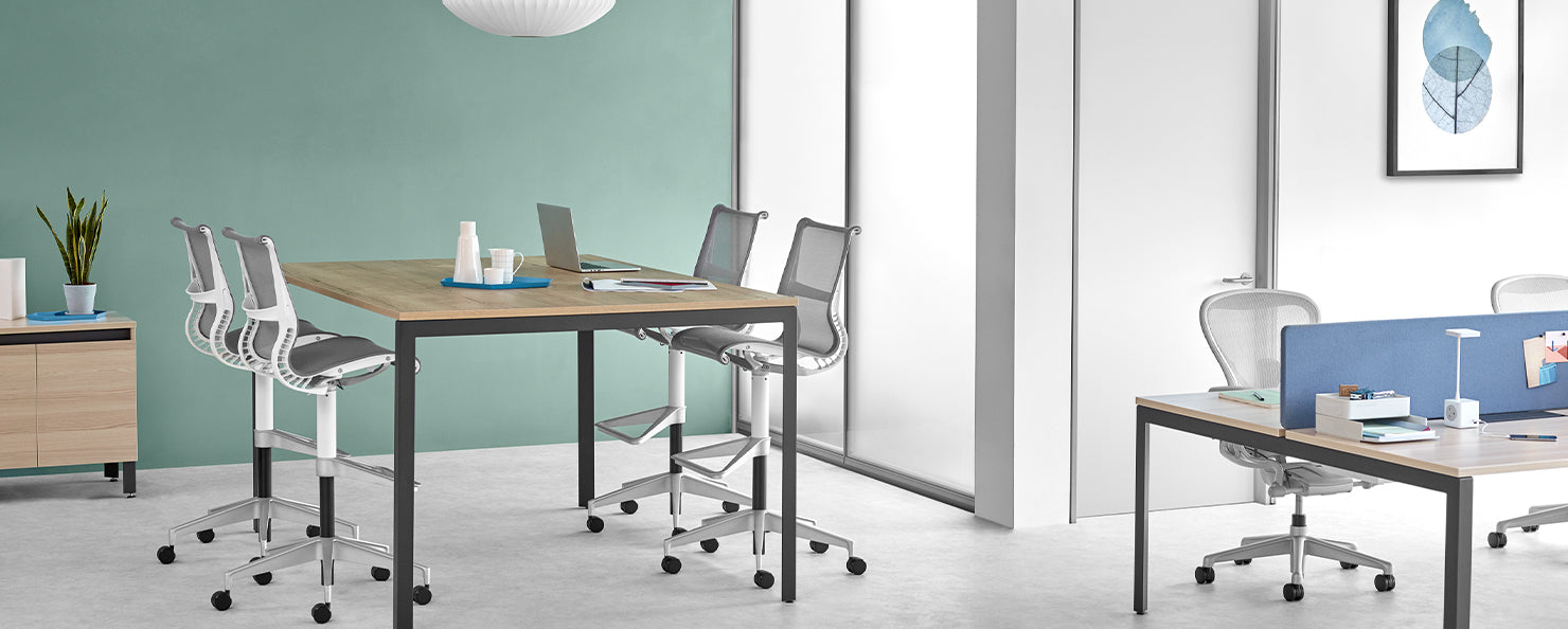 Four grey Setu stools in a casual meeting environment
