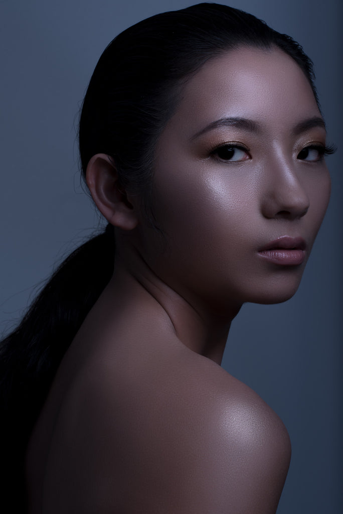 A close portrait shot of a woman with silky smooth skin.