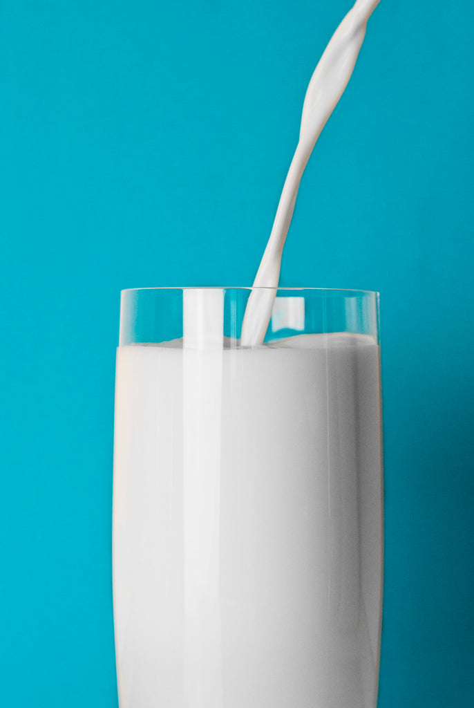 Milk is being poured in a glass.