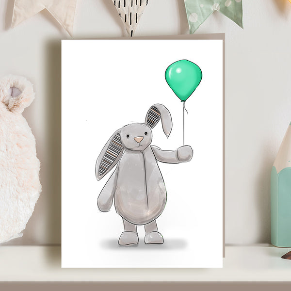 Cute bunny greetings card with green balloon. Soft toy, perfect for nursery, child's birthday or new baby