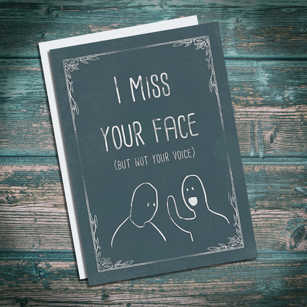 I miss your face. Funny backhanded cheeky greetings card. I miss you card.