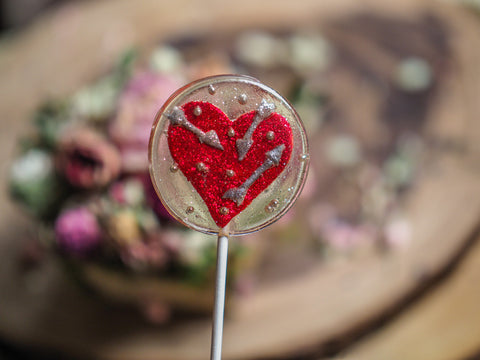 Chocolate & Raspberry Flavored Heart And Arrows Lollipop (One)