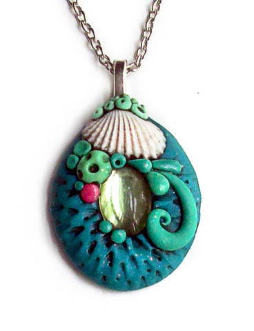 Seashell Pendant with Peridot Cabochon