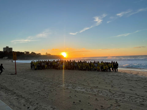 An Irish Crowd gathers on a Sydney beach for Darkness into Light