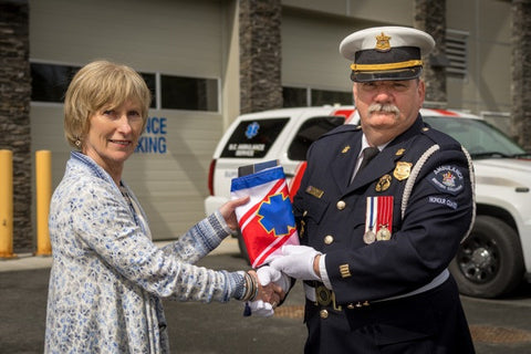 In the photo (L) Barbara Fitzsimmons COO BCEHS, (M) Lynn Klein BCAS 10-7  Association Society and ( R) Mike Wright CSM BCAS Honour Guard. Photo taken in  front of the BCEHS Vancouver Island communication centre, which is also paramedic  station 109.