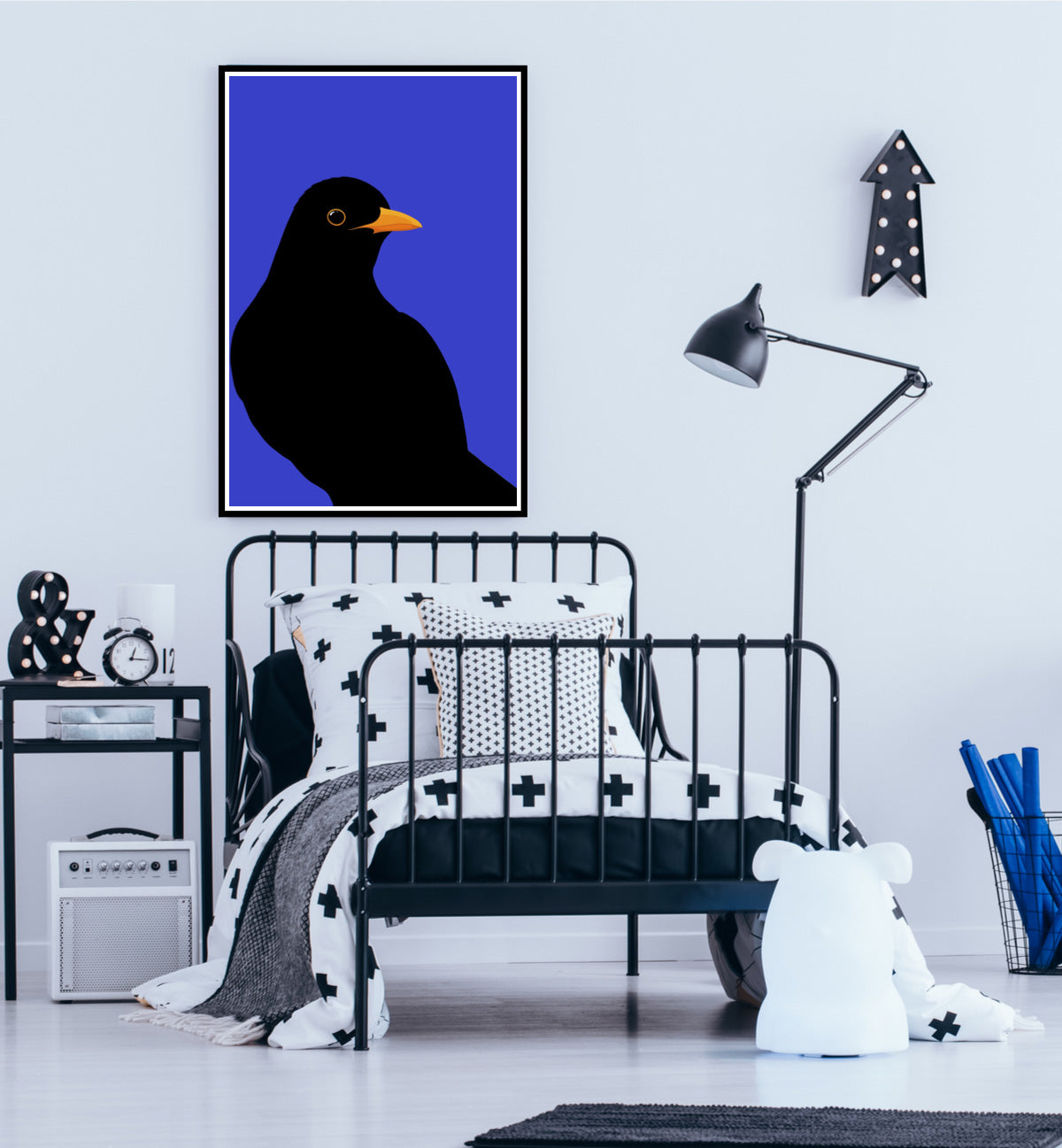 Framed print of the Blackbird on a bedroom wall