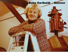 My mother in law Babe Garibaldi resting on a ladder by the wine press.
