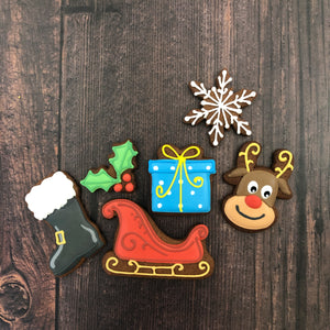 Santa's sleigh and boot, present, holly, Rudolph the red nose reindeer and a snowflake.