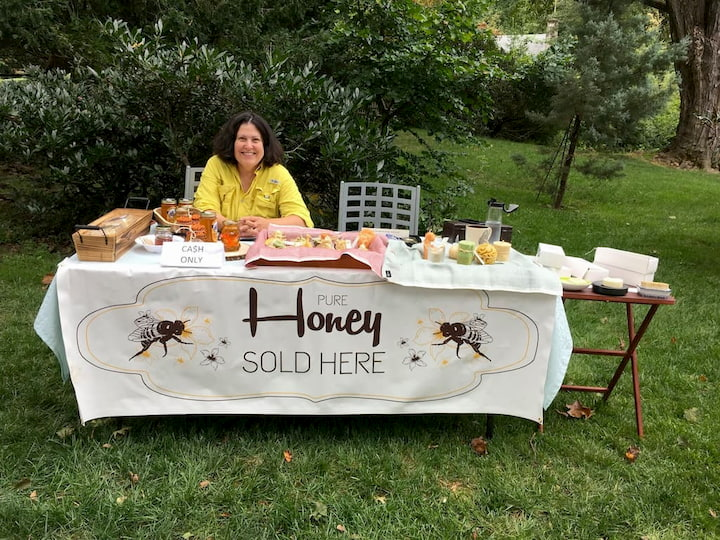 selling honey from table in the yard
