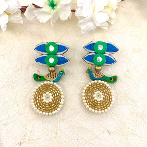 Peafowl on her Wrecking Ball Earrings